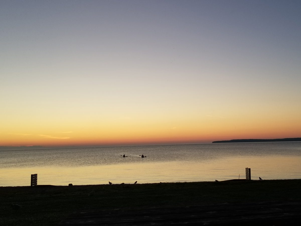 kayak during sunrise bavarian Haus Lakefront Inn